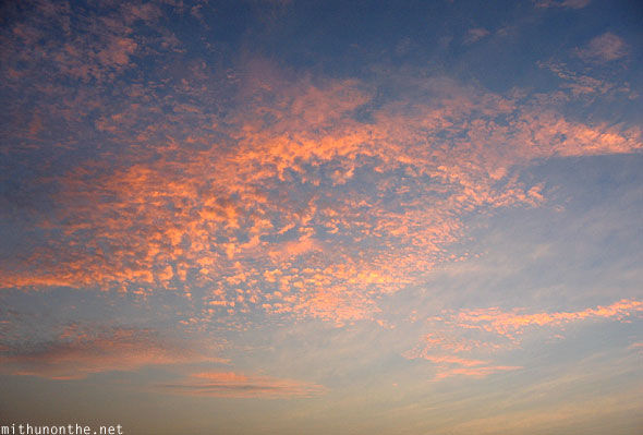 Evening orange pink clouds Beypore Kerala