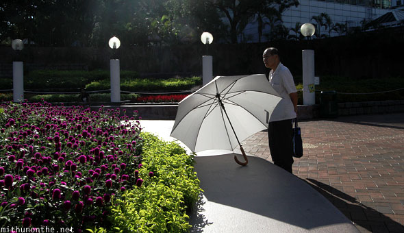 Kowloon park umbrella old man Hong Kong