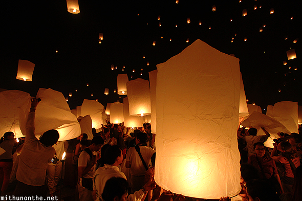 People releasing paper lanterns