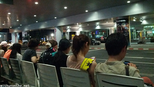 Waiting for bus Impact Arena