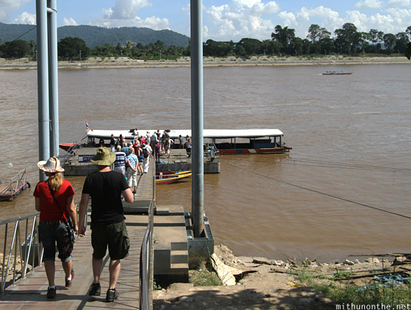 Tourists boarding Mekong river boat