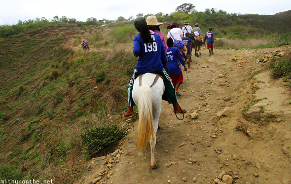 Horse ride climbing Taal hill Philippines