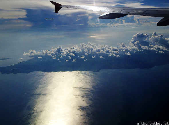 Afternoon flight over sea Philippines island