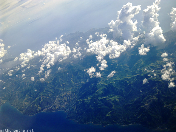 Flying over island clouds Philippines