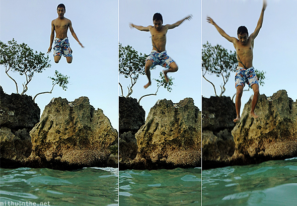 Guy jumping into water Boracay