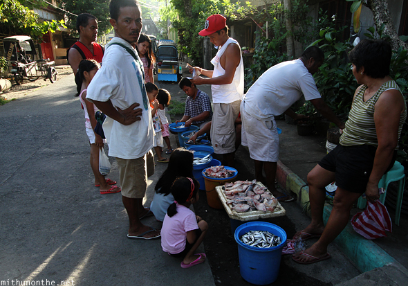 Filipino villagers buying fish