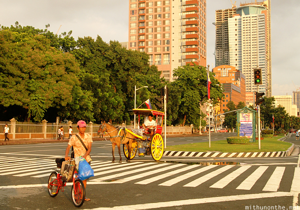 Roxas Blvd Manila evening horse cart