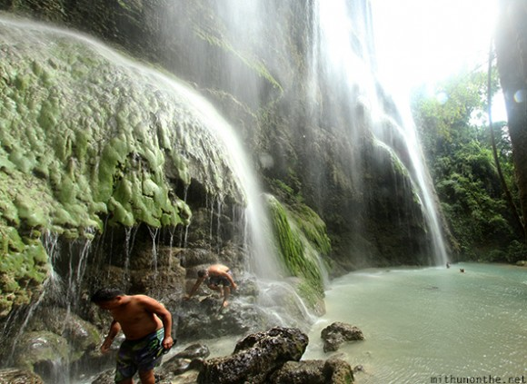 Tourists showering Tumalog waterfalls Oslob Cebu