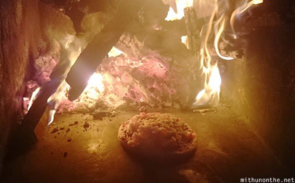 Baking pizza wood fire oven