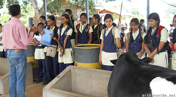 Santosh explaining school children milk production