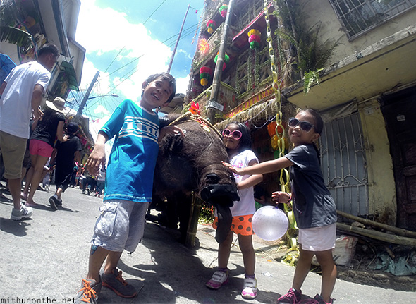 Children posing with Carabao Lucban