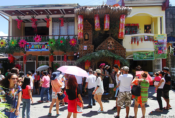 Crowds in front houses Pahiyas festival