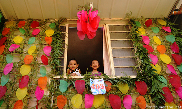 Kids looking out window Pahiyas Lucban