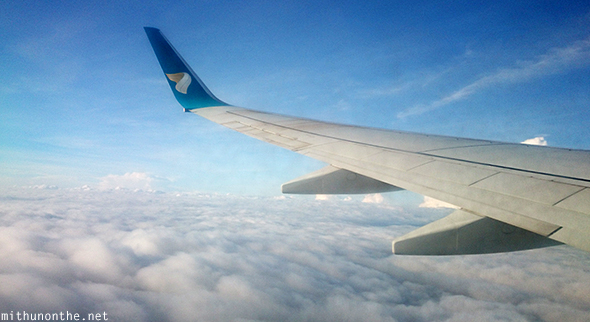 Oman Air wing above clouds
