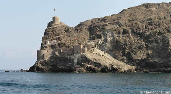Mountain fort by sea Muscat Oman