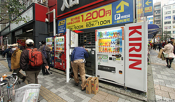 Kirin vending machine getting refilled