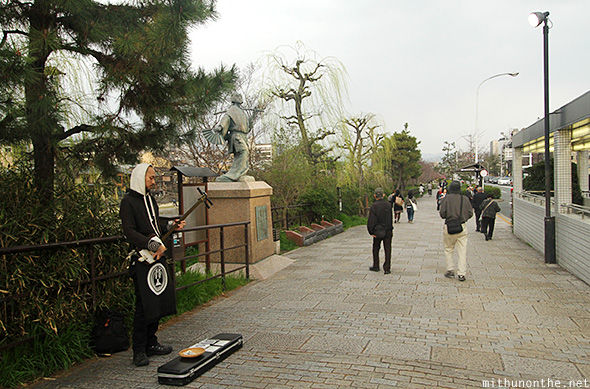 Shamisen player street Kyoto Japan