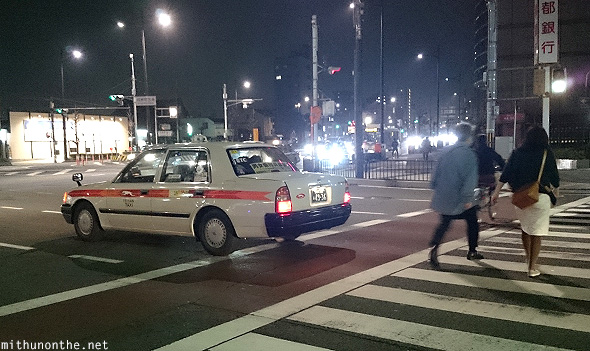 Taxi pedestrian crossing Kyoto Japan