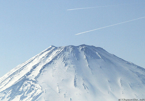 Planes flying over Mount Fuji peak Japan