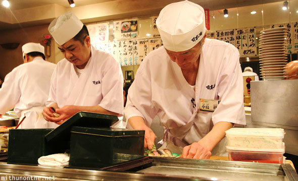 Sushi chefs conveyor belt restaurant