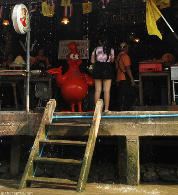 Chicken mascot looking at girl Thailand