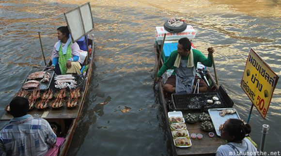 Boat vendors selling seafood Amphawa Thailand